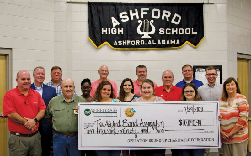 Group of people holding a check at the Ashford High School.