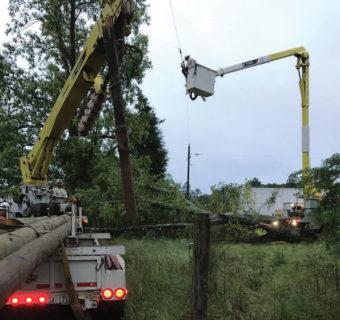 WEC crews fix a utility pole