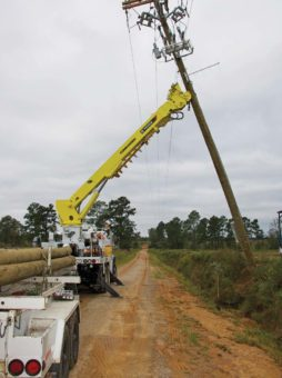 Work on a power line being done by linemen.