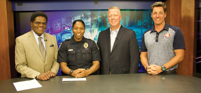 Pictured from left are WTVY anchor Reginald Jones, Enterprise police officer Tina Johnson, WEC COO Brad Kimbro, and WTVY Vice President and General Manager Spencer Bienvenue during the Silent Hero segment of the nightly news.