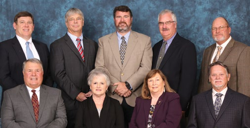 The board of trustees posing for a picture