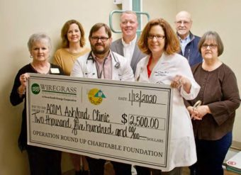 Members of the health clinic holding a large check.