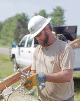 Allen Langford, a linemen, working on a power pole.