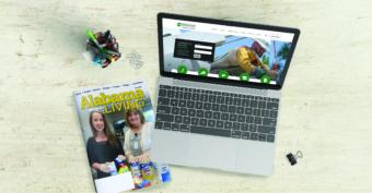Alabama Living magazine next to laptop