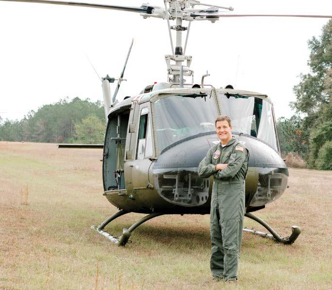 Dothan resident and Wiregrass Electric Cooperative member Jeff Coleman stands in front of a UH-1 Huey helicopter at Ozark Airport-Blackwell Field.