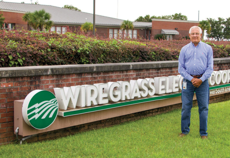 Danny Adams in front of Wiregrass Electric Cooperative sign.
