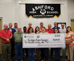 large group holding big check at the Ashford High School