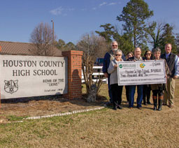 group from Houston County High School holding large check