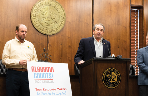 State House District 93 Rep. Steve Clouse, right, tells a crowd at the Dothan Civic Center that a poor participation rate in the 2020 census could cost Alabama an electoral vote as Houston County Commission Chairman Mark Culver stands in support.