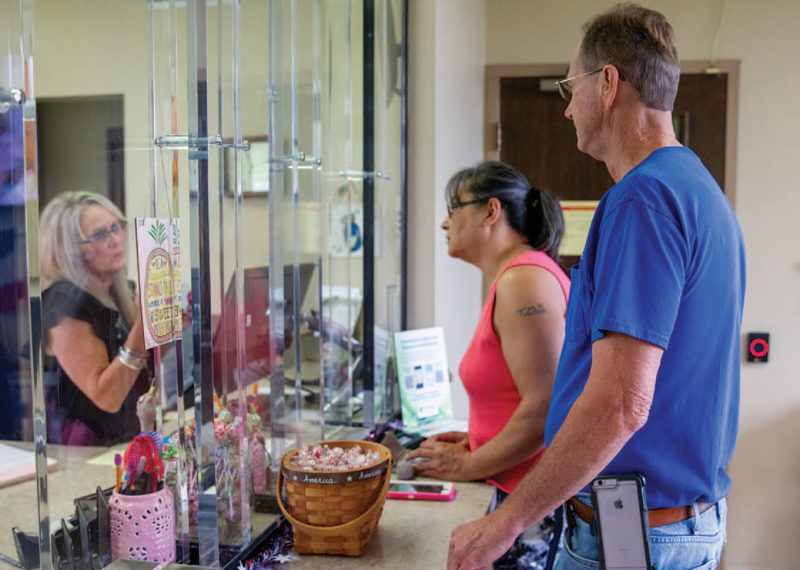 Member Services Representative / Lead Cashier Teresa Womack, left, assists members Randy Morrison, right, and Rebecca Marshall at Wiregrass Electric Cooperative's Ashford office.