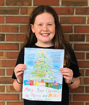 First-place winner, Leighton Gilmore, holding her drawing.